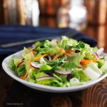 Damaged Salad Leaves Massively Stimulate Salmonella Growth