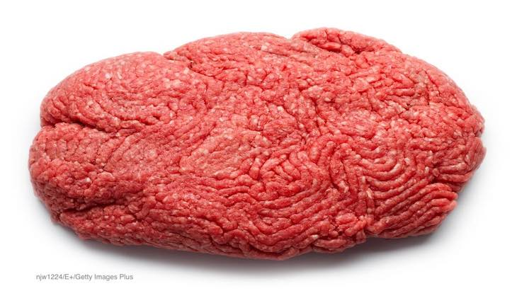 How is ground beef contaminated with E. coli?