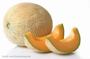 Whole and Sliced Cantaloupe
